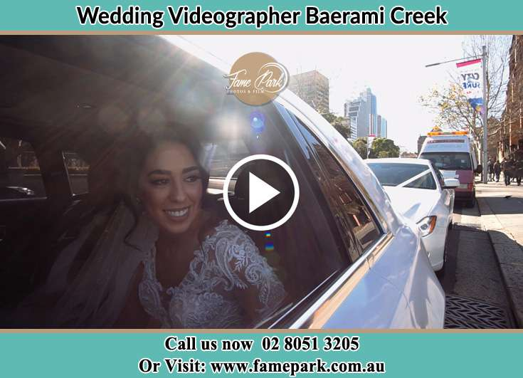 The Bride smiles inside the wedding car Baerami Creek NSW 2333