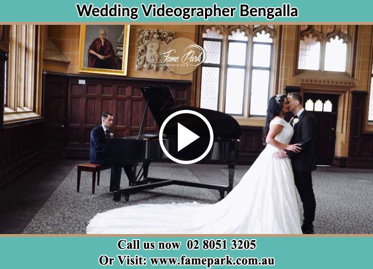 The newlyweds dancing with the pianist playing their song Bengalla NSW 2333