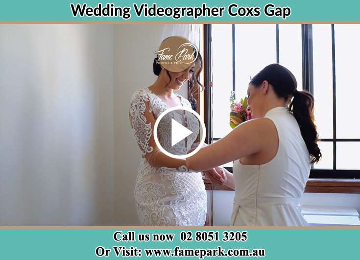 A woman helping the Bride to get ready for the wedding Coxs Gap NSW 2333