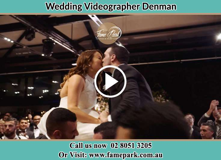 The newlyweds kissing Denman NSW 2328