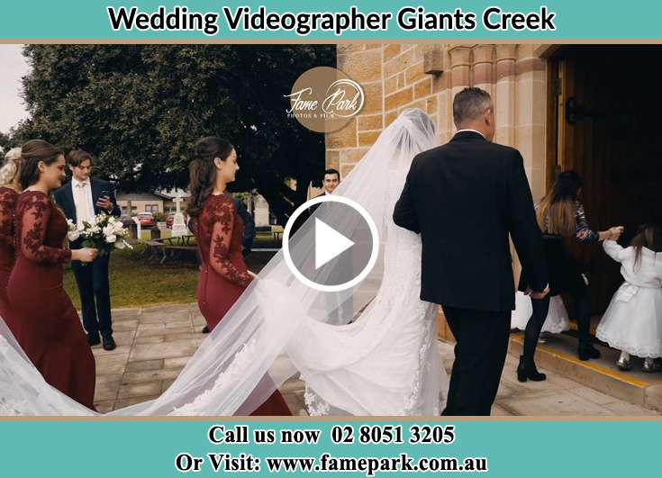 The Bride entering the wedding venue with her father Giants Creek NSW 2328