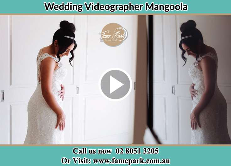 Bride looking at the mirror while preparing Mangoola NSW 2333