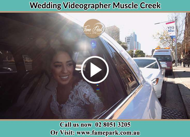 The Bride smiling inside the wedding car Muscle Creek NSW 2333