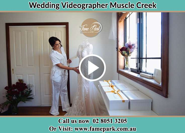 The Bride checking her wedding dress Muscle Creek NSW 2333