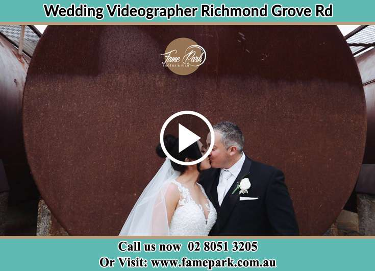 The newlyweds kissing Richmond Grove Rd NSW 2333