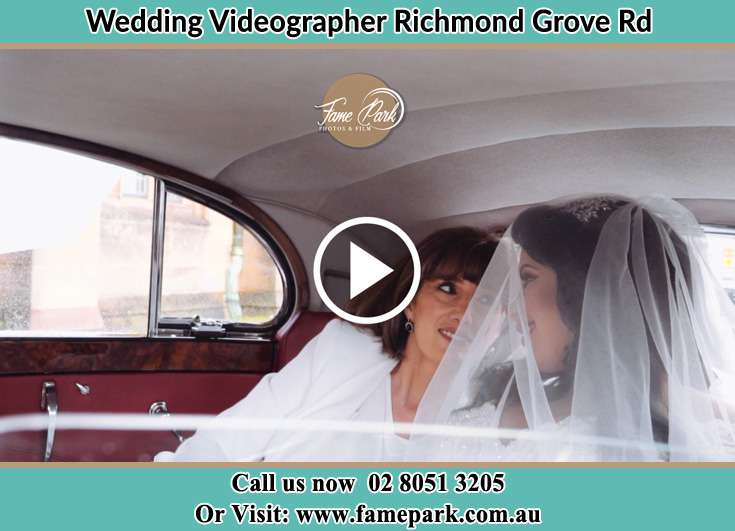 The Bride and her mothe smiling inside the wedding car Richmond Grove Rd NSW 2333