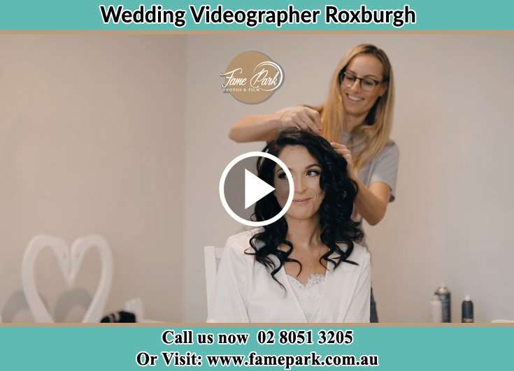 A woman helping the Bride to get ready for the wedding Roxburgh NSW 2795