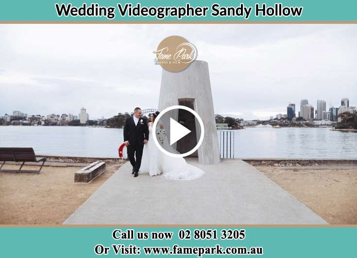 The newlyweds walking away from the shore Sandy Hollow NSW 2333