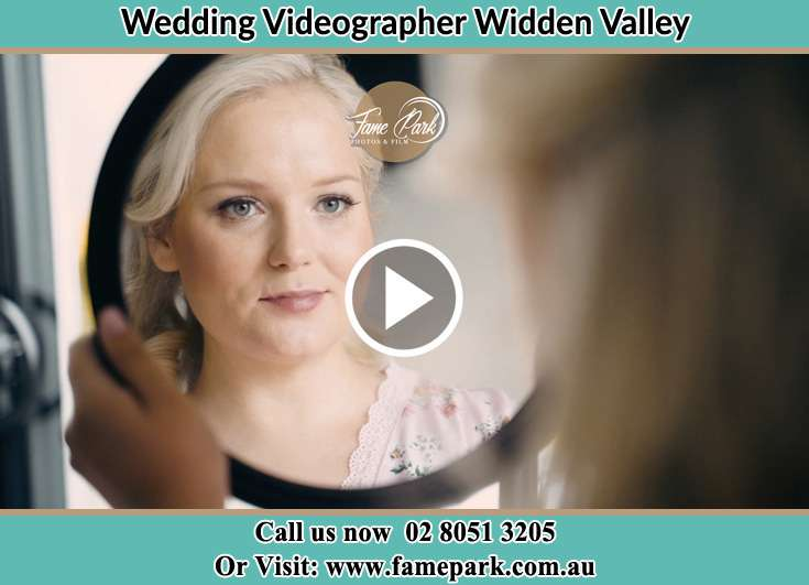 The Bride looking at the mirror Widden Valley NSW 2238